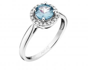 White gold ring with diamond and topaz (London Blue)