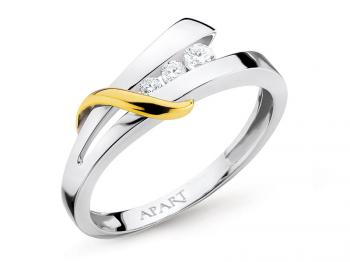 White and yellow gold ring with brilliants