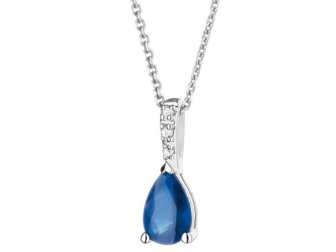 White gold pendant with diamonds and sapphire