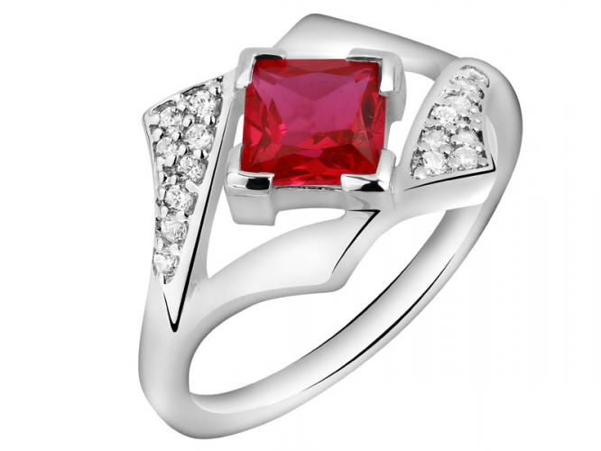 Ring with cubic zirconias and synthetic corundum