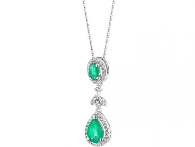 White gold pendant with brilliants and emeralds