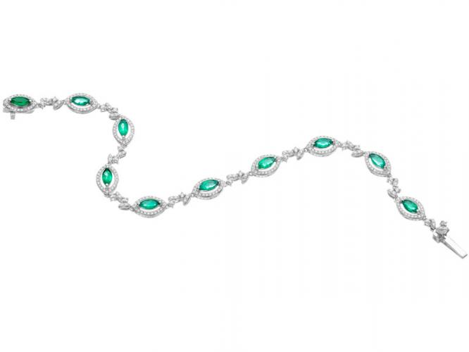 White gold bracelet with brilliants and emeralds