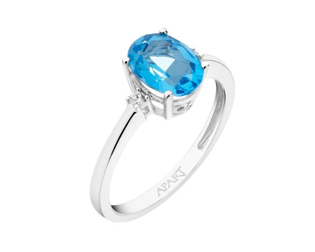 White gold ring with brilliants and topaz