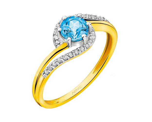Yellow gold ring with diamonds and topaz