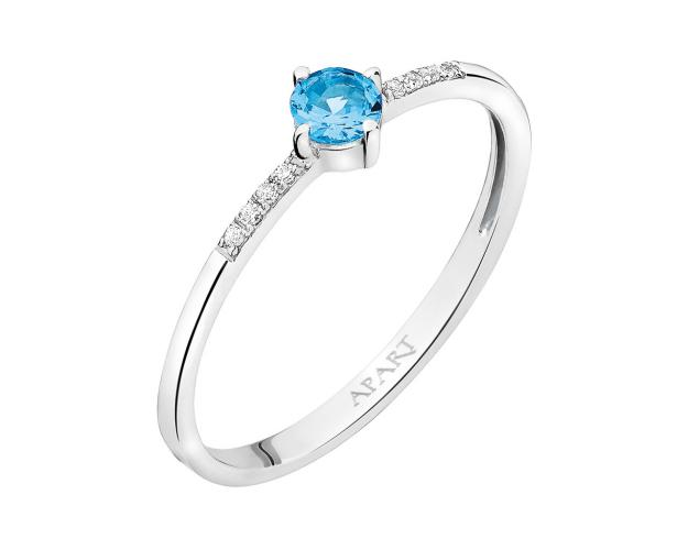 White gold ring with diamonds and topaz