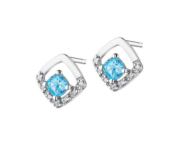 White gold blue topaz and diamond earrings