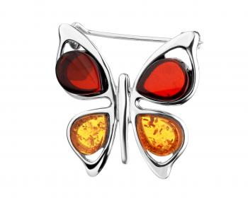 Silver brooch with amber