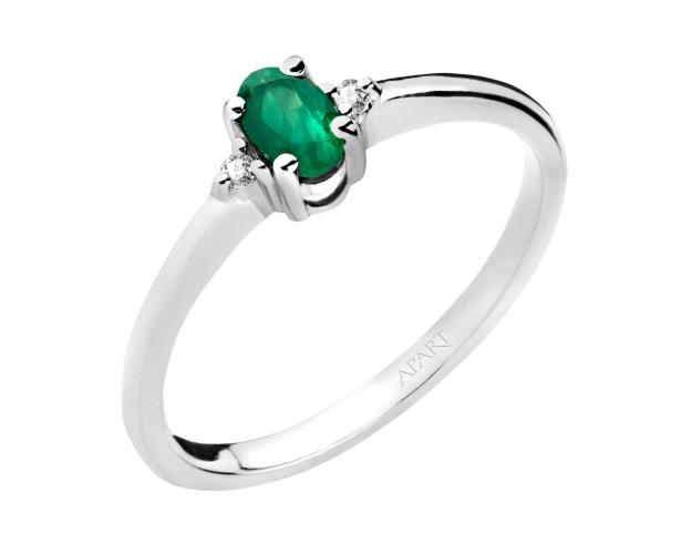 White gold ring with brilliants and emerald